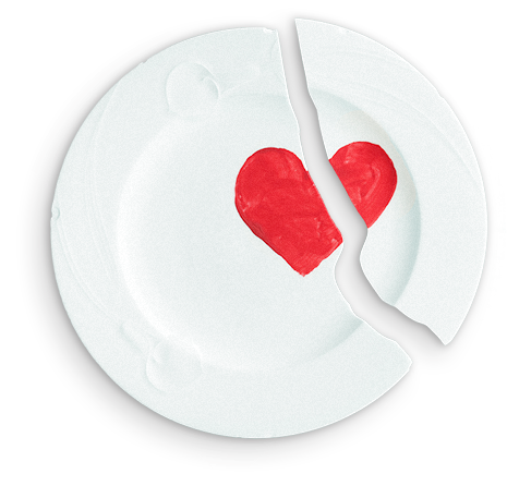 dinner plate with a design of a heart, broken into two pieces